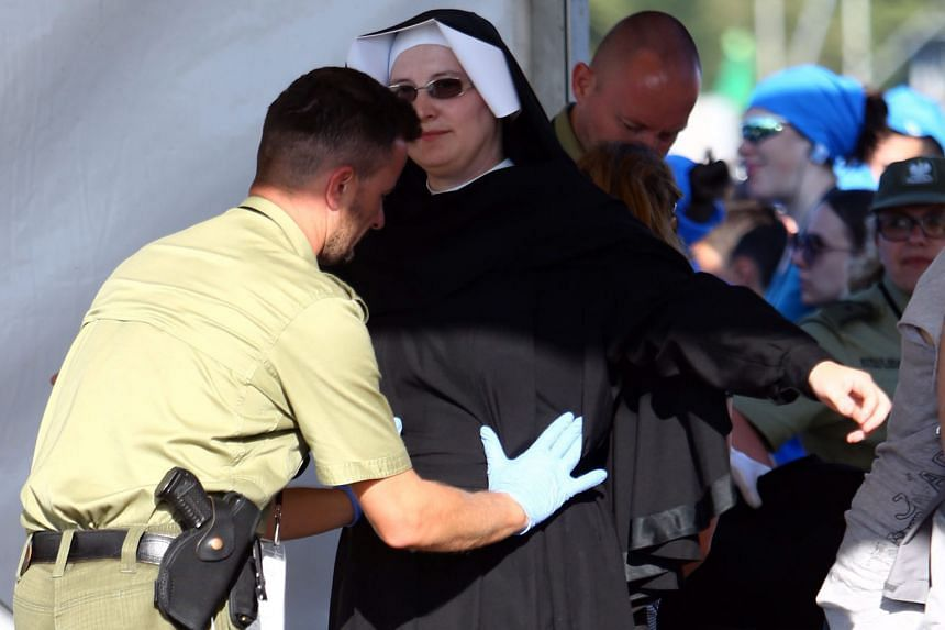 A nun participating in World Youth Day 2016 undergoing a security check before the Stations of the Cross mass with Pope Francis in Blonia Park in Krakow, Poland, over the weekend. World Youth Day 2016, which is being held in Krakow and nearby Brzegi,