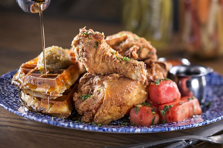 Yardbird's Llewellyn's Fried Chicken with watermelon cubes, cheddar cheese waffle and bourbon maple syrup.