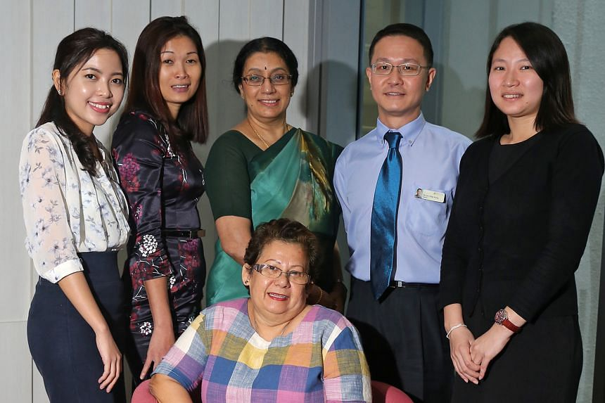 Madam Lyda Bakar Mathilda surrounded by some of those involved in the study (from left) coordinator Nurfaziela Zainal, co-director Dr Loh Ping Tyug, director Prof A. Vathsala, co-director Dr Lim Chee Kong and manager Samantha Ong.