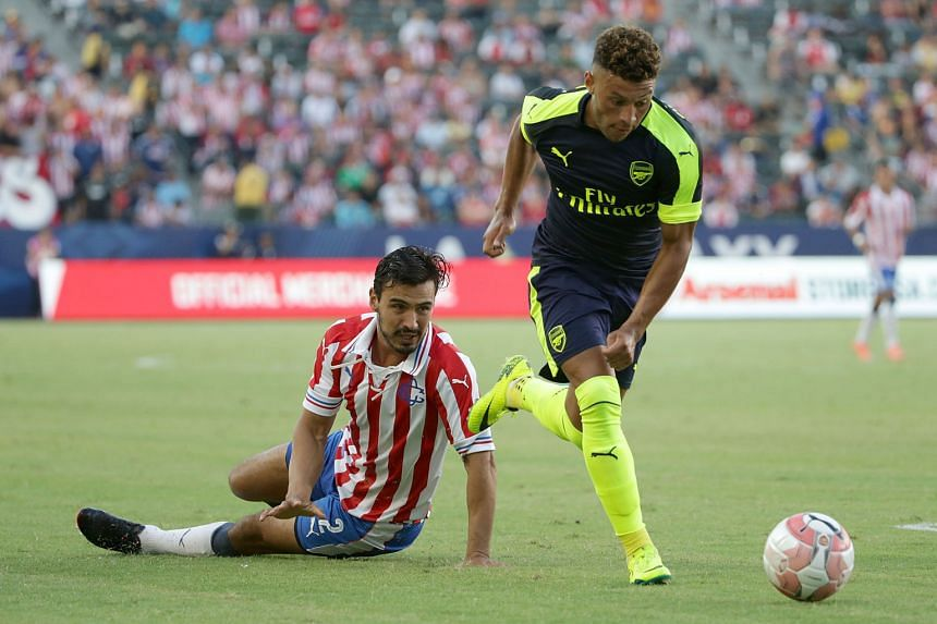 "Alex Oxlade- Chamberlain of Arsenal evading Guadalajara's Oswaldo Alanis during the second half of their pre-season friendly in California. His goal in the Gunners' 3-1 victory prompted Arsene Wenger to hail his ""power and penetration""."