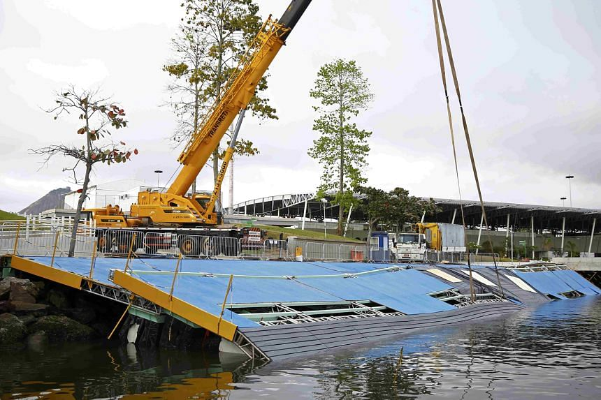 Repairs being carried out on the collapsed ramp at the Marina da Gloria sailing venue for the Games.