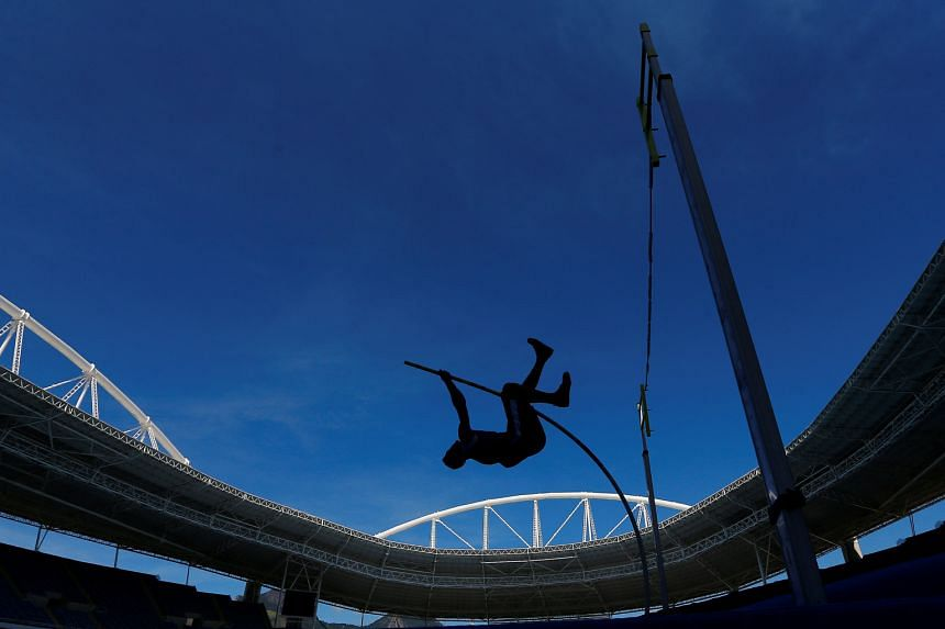 """Athletes competing to go faster and higher at the Rio Olympic Stadium in May at the Ibero-American Athletics championship, a Rio Olympics Test Event. The cost of organising the """"greatest show on earth"""" has spiralled, with Russia spending US$51 bi"""