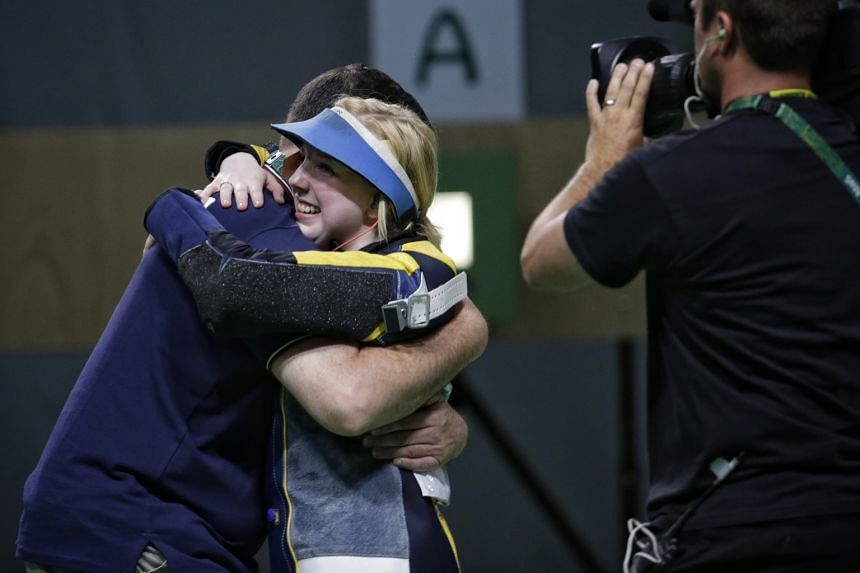Virginia Thrasher is congratulated by her coach after the 19-year-old US shooter held her nerve to win the women's 10m air rifle gold medal at the Olympic Shooting Centre yesterday.