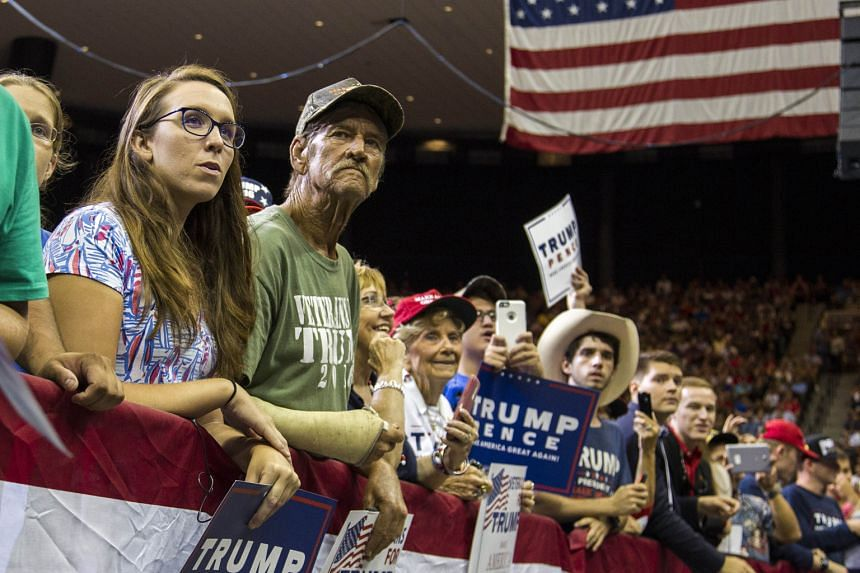 Supporters listening to Republican presidential nominee Donald Trump speak last Wednesday in Jacksonville, Florida. To working-class white Americans, Mr Trump is the one politician who actively fights elite sensibilities, whether they are good or bad