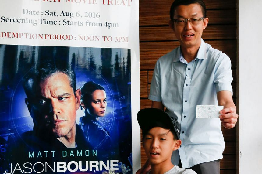 Mr Andy Tan and his son Jerome were among those who received tickets for action thriller Jason Bourne.