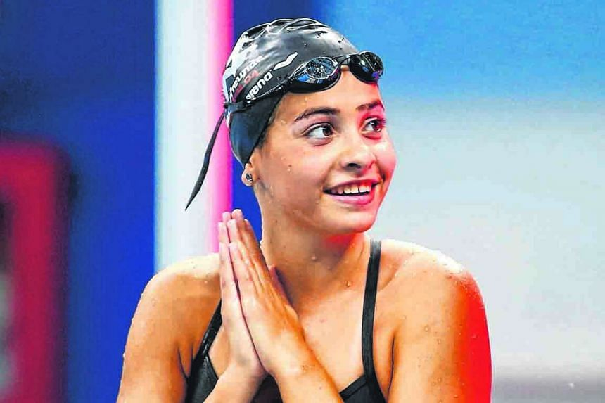 Yusra Mardini swimming in the 100m butterfly heats. The Syrian, hosted by Germany but swimming for the IOC-backed refugee team, has been soaking in her first Olympic experience, amid the attention around her team.