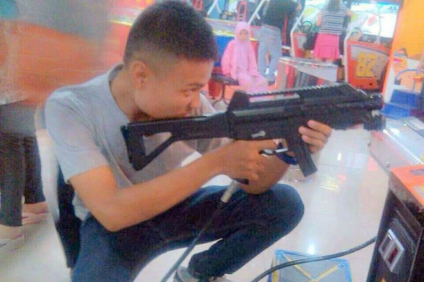 Mr Tegar, seen here playing an arcade game, was among six suspected militants nabbed in Batam last Friday, but was released that evening after questioning. His friend Hadi remains in police custody.