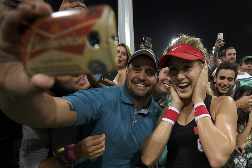 Canada's Eugenie Bouchard taking a celebratory selfie with spectators at the Olympic Tennis Centre after winning her first-round singles match against American Sloane Stephens 6-3, 6-3.