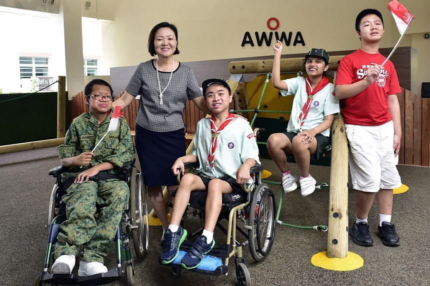 Mrs Seah with her students (from left) Joshua Ng Cai Ming, 16; Malcom Yew Kai, 15; Sarah Nurul Ain Ismail, 12; and Chin Ming Hui, 14. She started structured CCAs for the school's students. Now, there are 18 such CCAs in areas such as sports and the a
