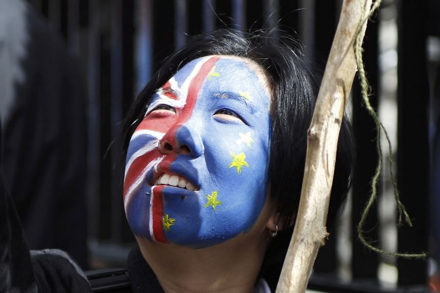 A woman at a protest march against Brexit. Britain's decision to leave the European Union has been a cause of concern for economists looking at Singapore's growth outlook.