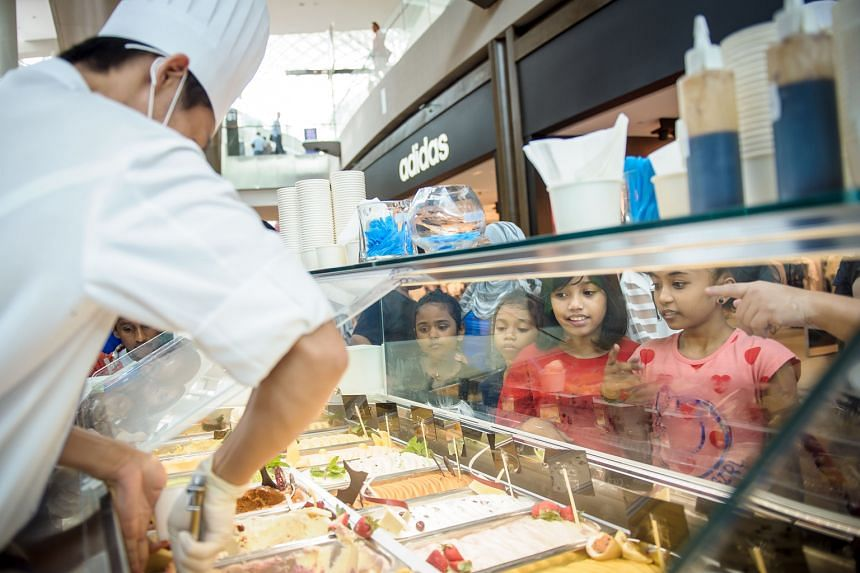 Straits Times School Pocket Money Fund beneficiaries selecting flavours at the Scoops of Hope booth. Earnings from 9,778 scoops of gelato sold at MBS went to the fund.