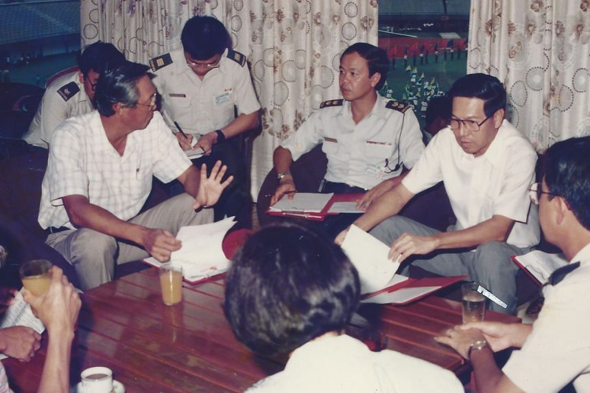 Mr Wong (centre, in uniform) talking to then First Deputy Prime Minister and Minister for Defence Goh Chok Tong and Second Deputy Prime Minister Ong Teng Cheong during an NDP rehearsal. Mr Wong, 65, at the new National Stadium. In 1989, he was the ch