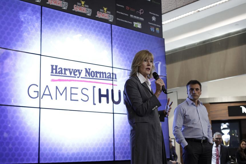 Ms Page at the launch of the Harvey Norman Games Hub, the first such gaming-focused installation by the Australian retail chain. Mr Pao (left) with a customer at the Harvey Norman Games Hub media launch last week. The HTC vice-president said his comp
