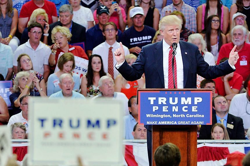 """At a Wilmington rally on Tuesday, Mr Trump said Mrs Clinton wished to abolish the right to bear arms and that it would be """"a horrible day"""" if she were elected and got to appoint a tiebreaking Supreme Court justice."""