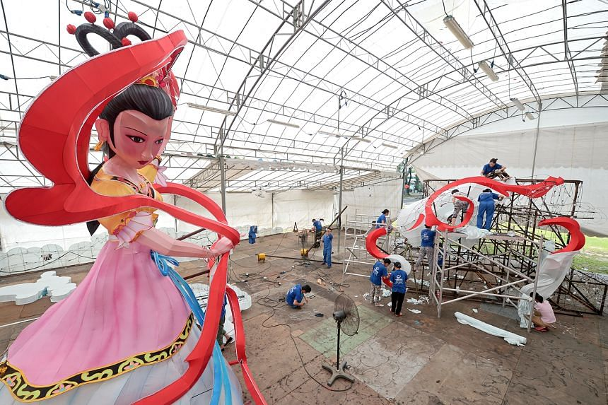 Craftsmen from China's Sichuan province working on a lantern in the shape of the Chinese moon goddess Chang'e, which will be the centrepiece of this year's Mid-Autumn Festival. It is among the lanterns designed by the faculty and students from Nanyan