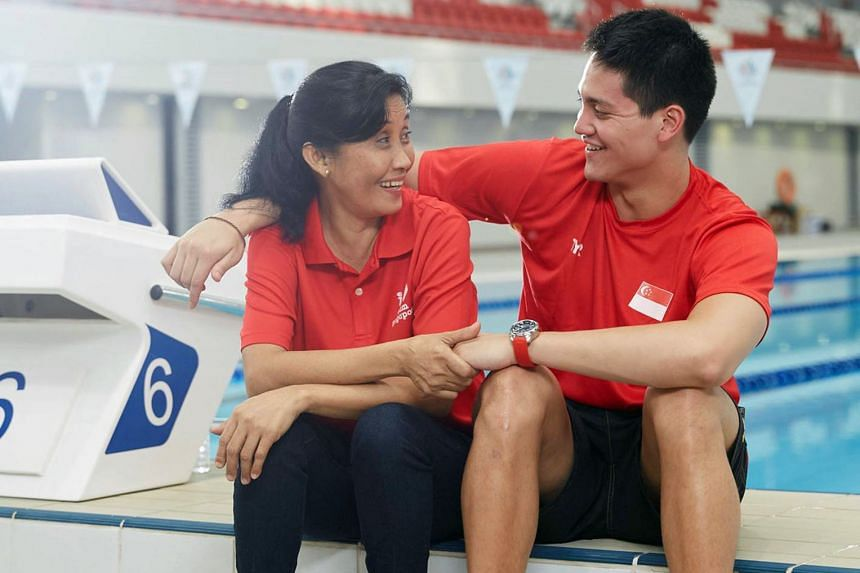"""In a YouTube video posted by Singtel, Schooling showed his appreciation for his domestic helper of 19 years, Ms Pascual, or """"Auntie Yolly""""."""