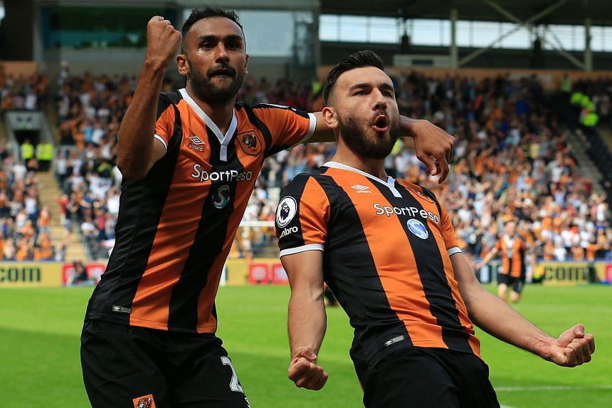 Hull midfielder Robert Snodgrass (right) celebrating with Ahmed Elmohamady after giving their side a lead against Leicester they would hold on to.