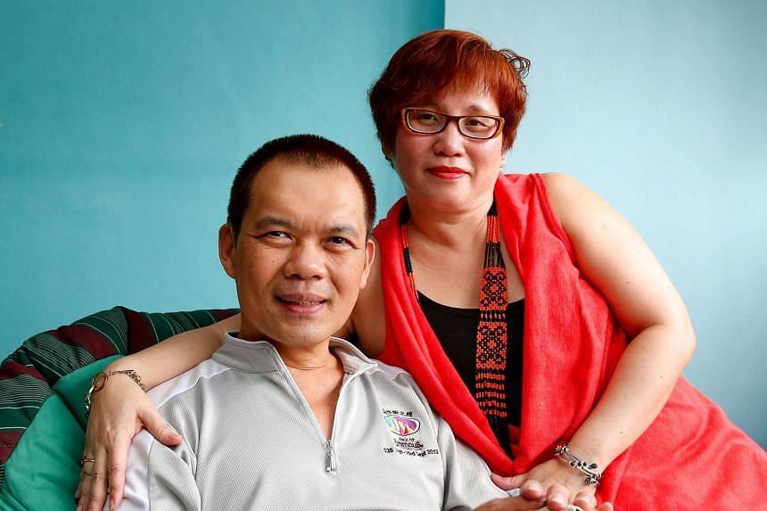 """After losing most of his hearing to a GBS infection last year, Mr Sim now relies on his wife, Madam Chew, to be his """"ears"""" at the coffee shop and at investment seminars. To communicate, he types on his iPad or writes on paper."""