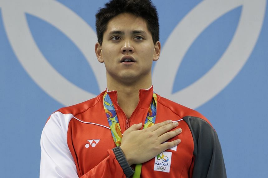 Hand on heart after the greatest swim in his life, new Olympic 100m fly champion Joseph Schooling savours a Majulah moment at the medal ceremony. His calm demeanour belies his pride and honour after his stupendous achievement.