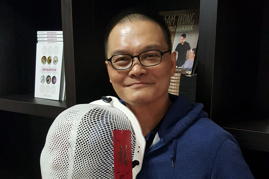 Chef Sam Leong with the mould of his face and body used to ensure that he did not move during his radiation sessions. He has put photos and a congratulatory red packet from his mother on it.