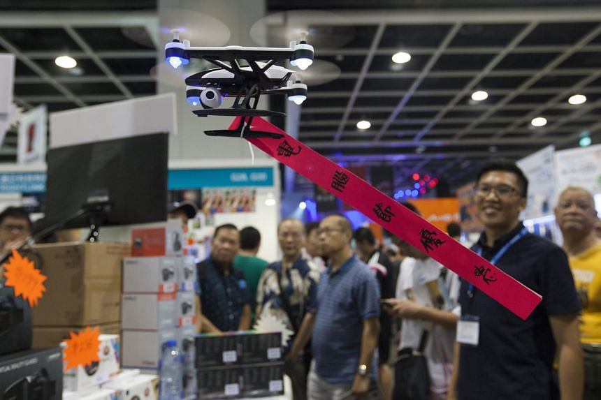 A drone at a technology fair in Hong Kong. Dealing with technology-enabled machines will be a key type of job in the future, says Mr Tan Soon Kim.