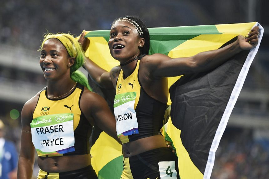 Jamaica's Elaine Thompson celebrates after winning the women's 100m final at Rio 2016. Shelly-Ann Fraser-Pryce, also of Jamaica, came third.