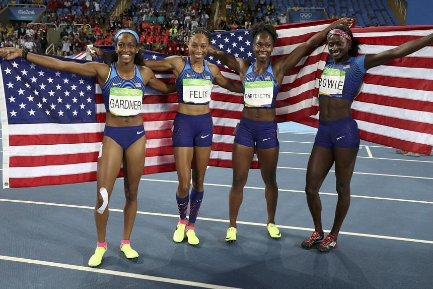 The victorious team of English Gardner, Allyson Felix, Tianna Bartoletta and Tori Bowie.