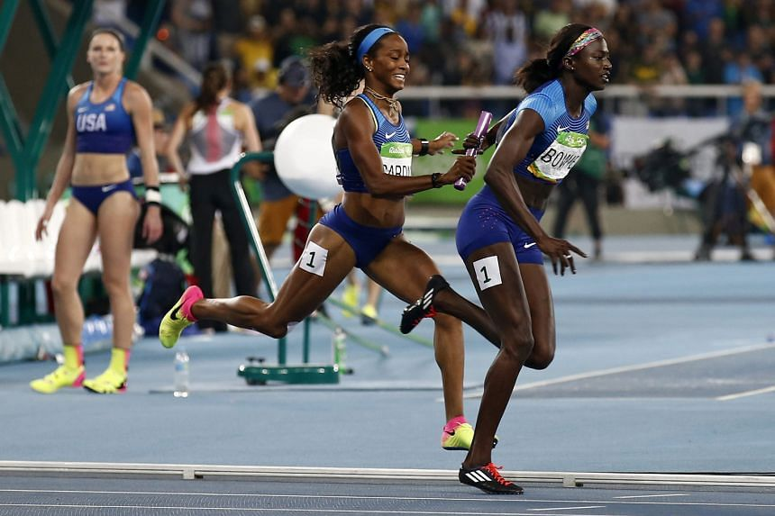 English Gardner passing the baton to Tori Bowie during the United States' 4x100m victory on Friday.