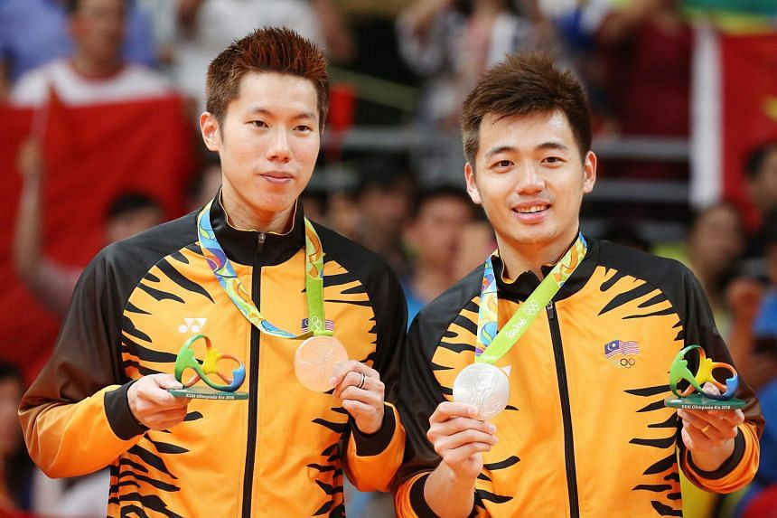 Chan Peng Soon and Goh Liu Ying; and (above) Goh V Shem (left) and Tan Wee Kiong with their silver medals.