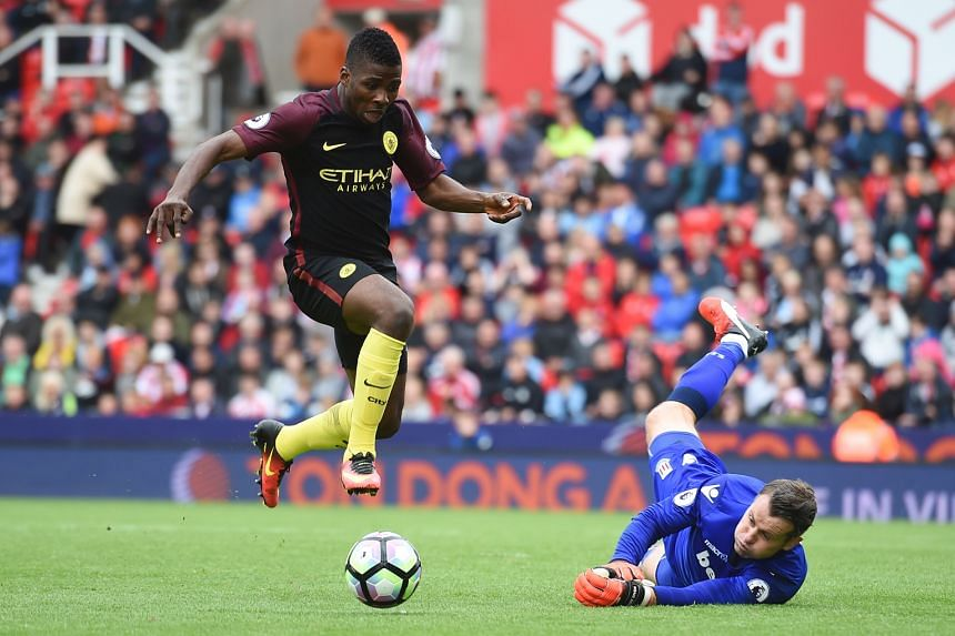 Manchester City's Kelechi Iheanacho taking the ball past Stoke City goalkeeper Shay Given in the build-up to their third goal scored by Nolito. City won the English Premier League match 4-1 with Sergio Aguero and Nolito scoring a brace each, taking t