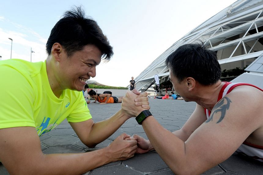 Participants spent the morning doing engaging exercises, including arm wrestling. The Polar fitness boot camp is one of the events leading up to the OCBC Cycle.