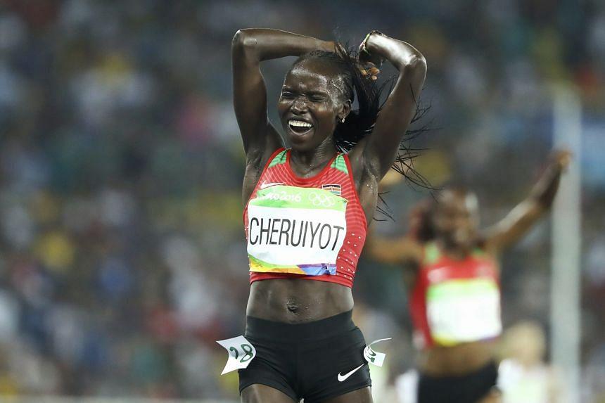 Vivian Cheruiyot of Kenya celebrating after winning gold in the 5,000 metres.