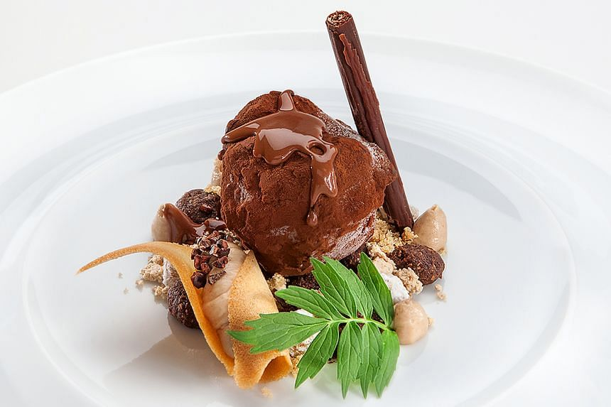 Parma's Mojito, a lime and mint risotto adorned with parmesan ice cream, and The Truffle (above), a dessert made of hazelnuts, chocolate and coffee and resembling a freshly unearthed truffle, are among dishes featured at Gusto Italiano.