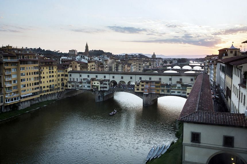 Uffizi Gallery director Eike Schmidt is fighting to keep open the museum's Vasari Corridor (above), which traverses Arno River via the top floor of Florence's Ponte Vecchio.
