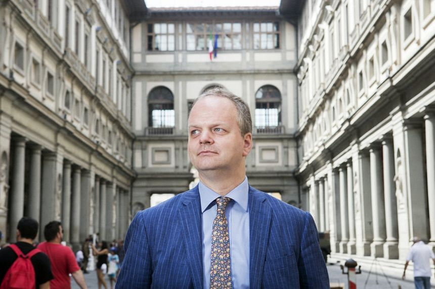 Uffizi Gallery director Eike Schmidt (above) is fighting to keep open the museum's Vasari Corridor (left), which traverses Arno River via the top floor of Florence's Ponte Vecchio.