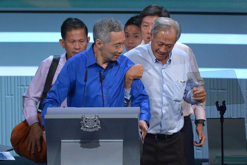 Pictures from above: Defence Minister Ng Eng Hen rushes to PM Lee's side after he took ill while delivering the National Day Rally speech yesterday. He is helped by Dr Ng off stage. Behind Dr Ng is Acting Education Minister (Schools) Ng Chee Meng. Mr