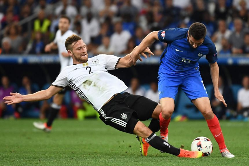 Germany defender Shkodran Mustafi (far left) vying for the ball with France forward Andre-Pierre Gignac in the Euro 2016 semi-final last month. Arsenal manager Arsene Wenger needs defensive cover fast as Laurent Koscielny is the only fit specialist c
