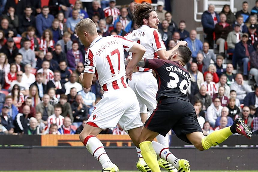 Stoke City's Ryan Shawcross fouling Nicolas Otamendi while defending a corner, which led to a penalty given to Manchester City.