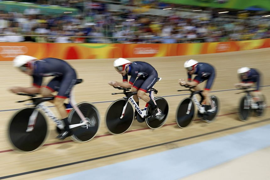 Britain's quartet on their way to gold in the team pursuit final against Australia. Cycling requires the most precise timing at the Olympics, taken to a thousandth of a second on the front wheel of the third rider across the line.