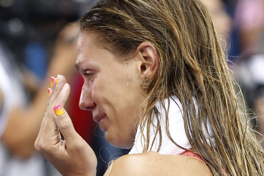 Russia's Yulia Efimova in tears after she finished second in the 100m breaststroke final at the Olympic Aquatics Stadium, where she was jeered throughout the race.