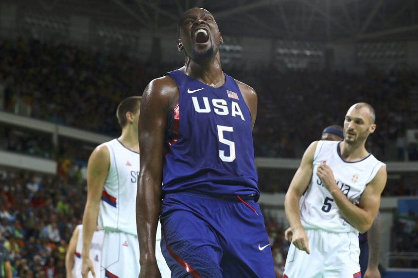 Kevin Durant, the top scorer with 30 points, reacting after a dunk, as Serbia's Marko Simonovic shows his frustration in the final. The gold was the US' 46th and final one in Rio.