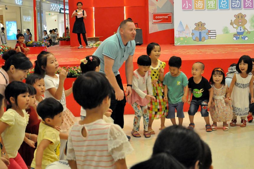 A team from Crestar Education interacting with children at a roadshow in Nanhai Business City in Foshan, China. Joining Mapletree's bigger project in the city has made it easier for SMEs like Crestar Education to break into the local market.