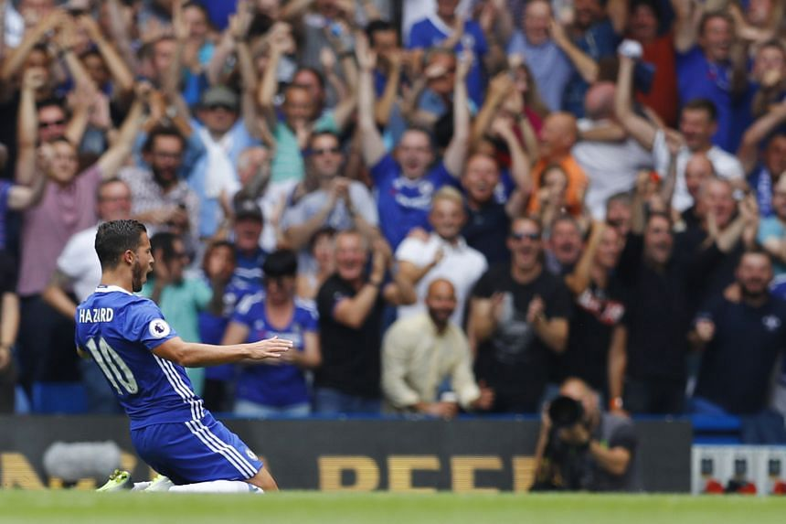 Eden Hazard (left) celebrating his ninth-minute goal against Burnley last night. Chelsea manager Antonio Conte maintained a winning start to his English Premier League career with the win at Stamford Bridge. The Blues scored early in the ninth minute