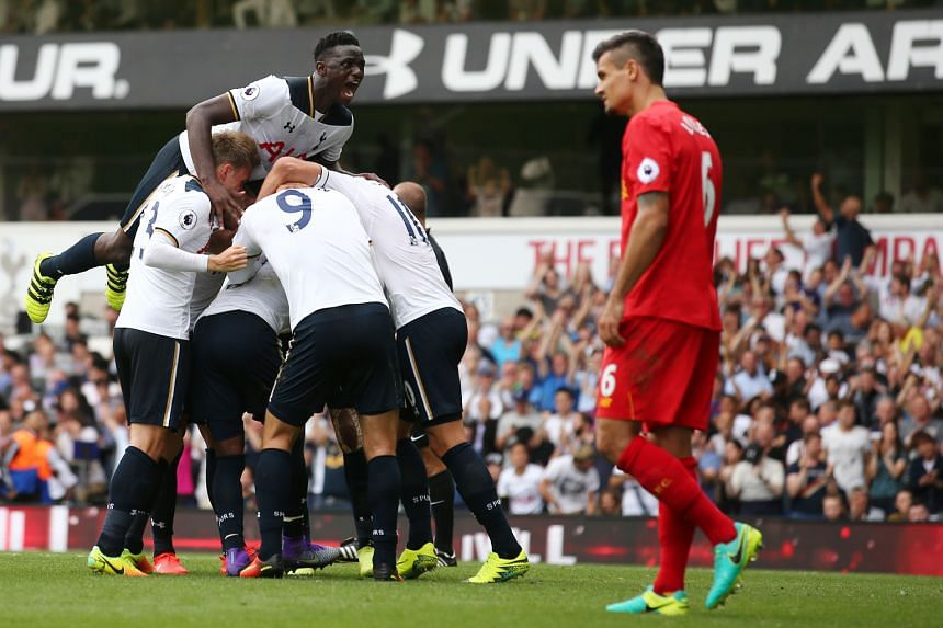 Tottenham Hotspur players celebrating the second-half equaliser from defender Danny Rose against Liverpool last night. The 1-1 draw ensured that Spurs continued their unbeaten start to the season.