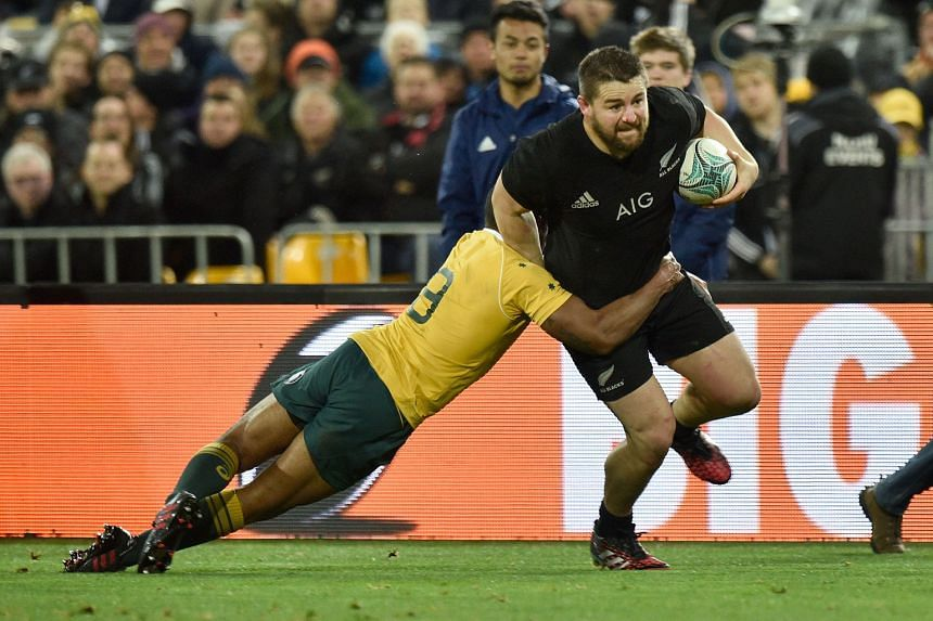 New Zealand's Dane Coles (right) being tackled by Australia's Will Genia in Wellington yesterday. The All Blacks' 29-9 win, coupled with their victory a week earlier, gave them the Bledisloe Cup for the 14th consecutive year. Australian coach Michael