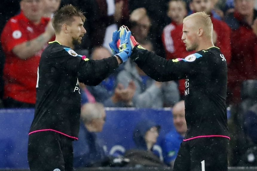 Leicester City's Ron-Robert Zieler (left) coming on to replace Kasper Schmeichel, who limped off during the second half of their 2-1 Premier League victory over Swansea City on Saturday.