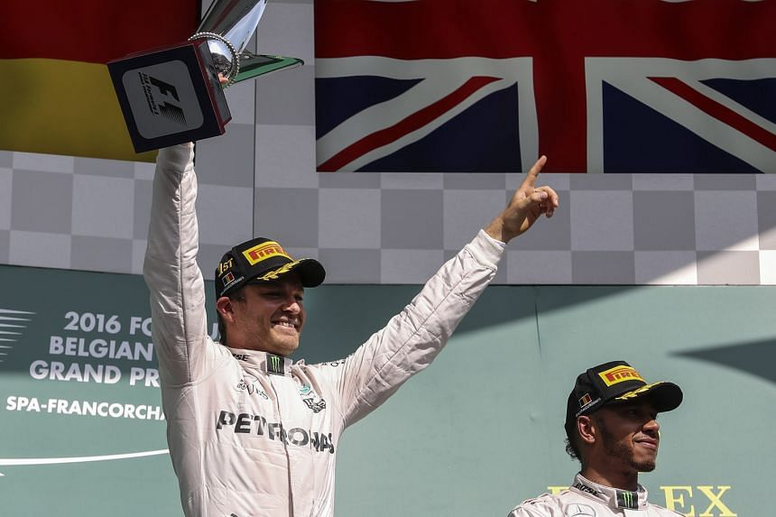 Nico Rosberg (left) celebrating his start-to-finish victory in the Belgian Grand Prix yesterday as his Mercedes team-mate Lewis Hamilton looks on. The Briton started 21st on the grid but finished in third position, while Red Bull's Daniel Ricciardo w