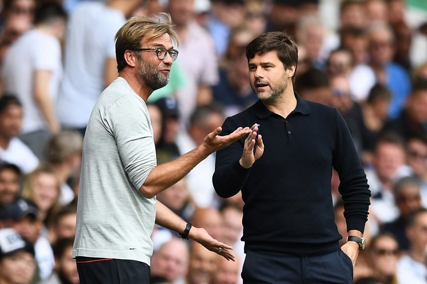 Liverpool manager Jurgen Klopp and Tottenham boss Mauricio Pochettino during the 1-1 draw in the Premier League on Saturday.