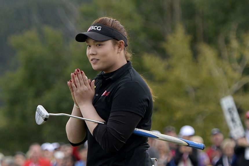 Ariya Jutanugarn of Thailand reacting after sinking her putt on the 18th green during the Canadian Pacific Women's Open final round on Sunday.