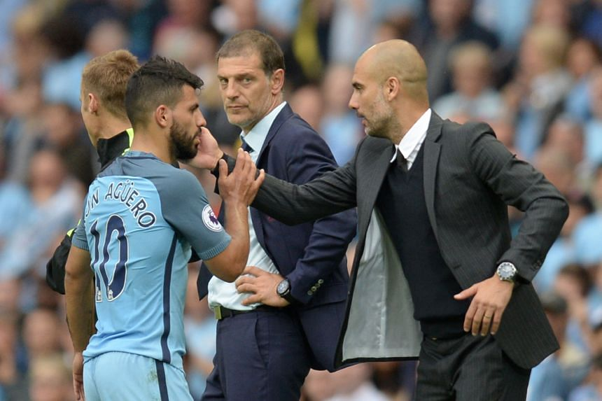 Manchester City manager Pep Guardiola acknowledging Sergio Aguero after he was substituted in the 3-1 English Premier League victory over West Ham on Sunday, as Hammers boss Slaven Bilic watches on. Aguero may miss the Sept 10 Manchester derby if he